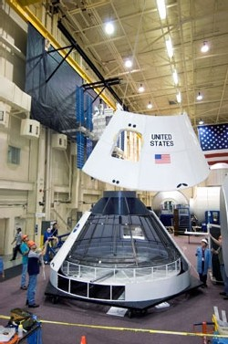 Image to right: A mockup of NASA's new spacecraft comes together. Credit: NASA